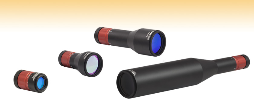 Fixed Magnification Beam Expanders: Achromatic