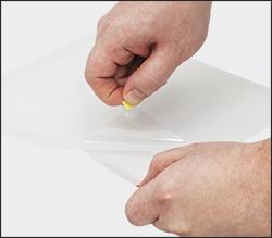 Peeling back front sheet from OCA