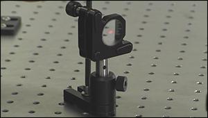 Beam spot centered on a much larger diameter mirror.