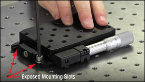 Using a mounting slot to secure a linear translation stage to an optical table or breadboard.