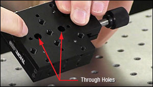The mounting points in the middle of a translation stage's base plate.
